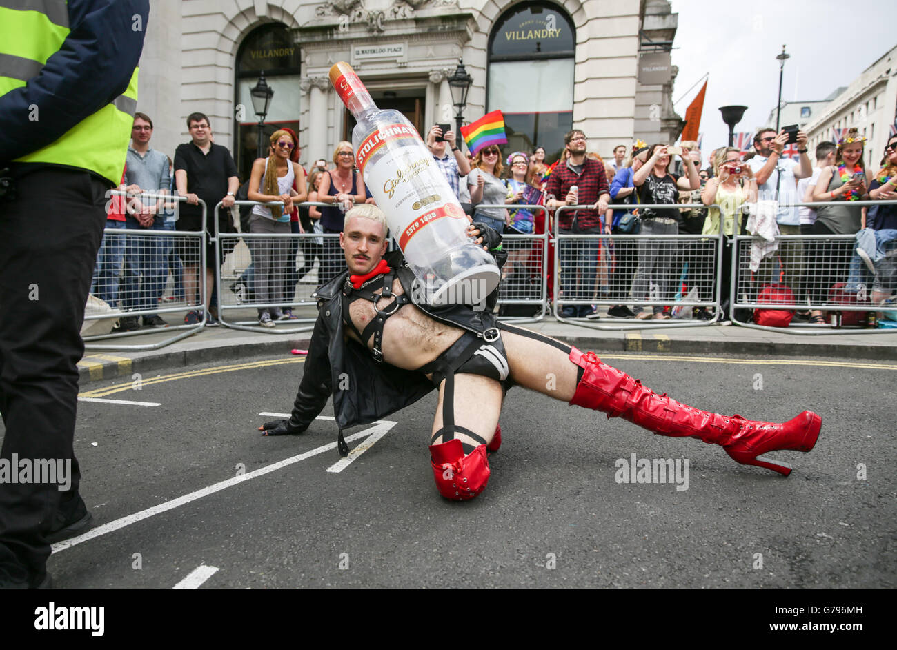 London, UK  25th June, 2016. Pride in London parade. parade participant with Stolnichya 'stoli' vodka bottle - Stock Image