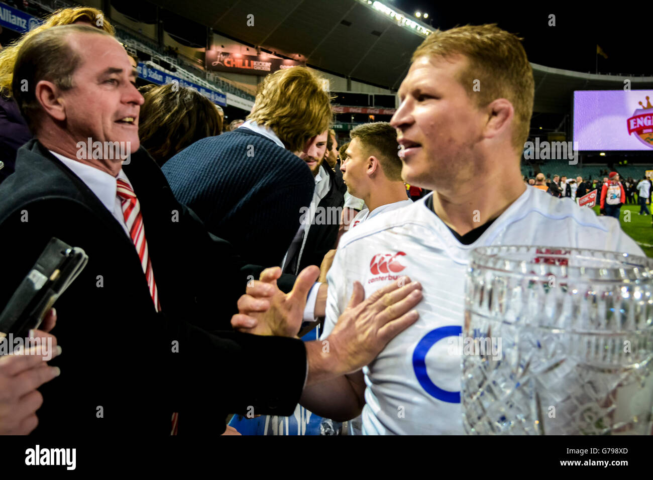 Sydney, Australia. 25 June, 2016. England rugby captain Dylan Hartley and his tearful father with the Cook Cup trophy - Stock Image