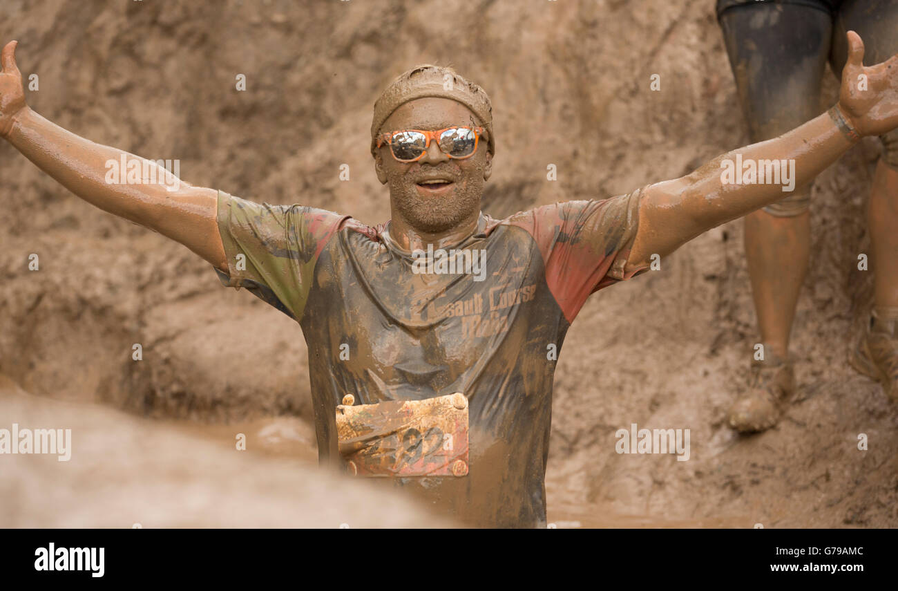 Man mud glorious mud on the Mud Mile obstacle at Tough Mudder at Drumlanrig Castle, Dumfries and Galloway, Scotland, - Stock Image