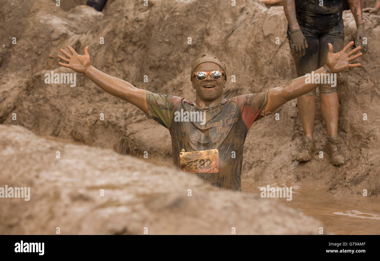Mud glorious mud on the Mud Mile obstacle at Tough Mudder at Drumlanrig Castle, Dumfries and Galloway, Scotland, - Stock Image