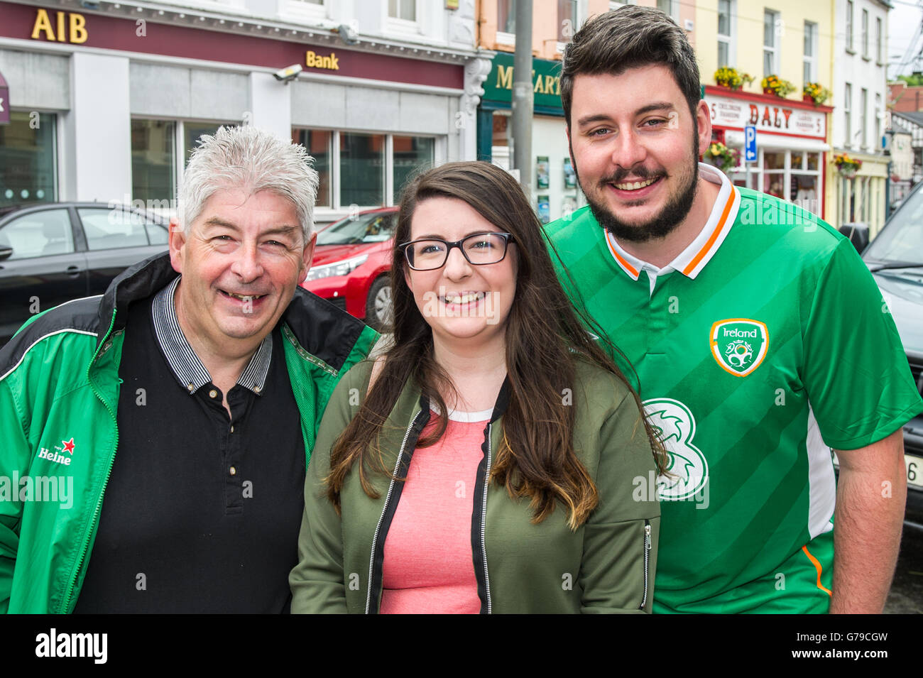 Skibbereen, West Cork, Ireland. 26th June, 2016. Ireland fans Brian, Rebecca and Shane Hourihane, all from Skibbereen, - Stock Image
