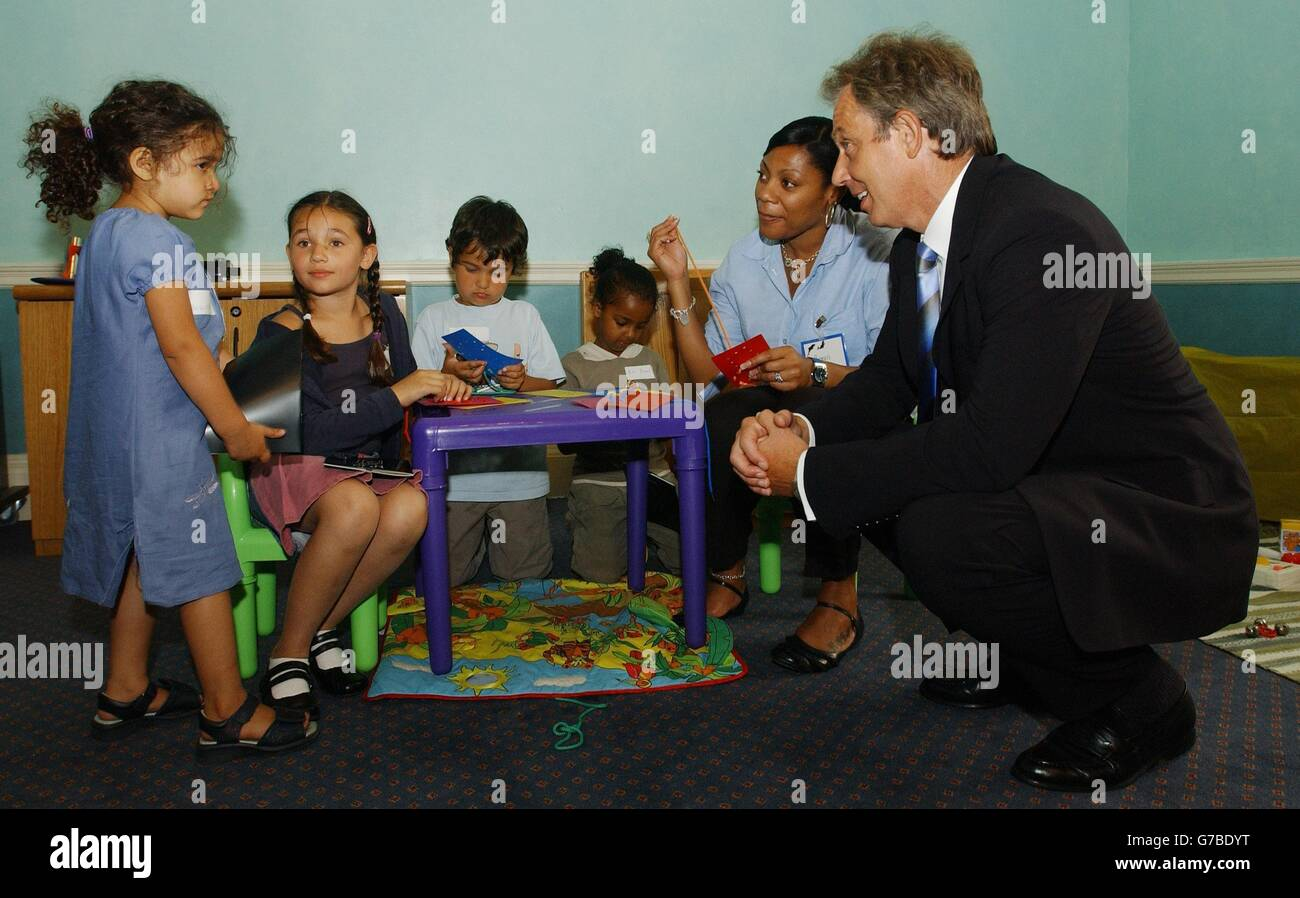 Blair with childcare workers - Stock Image