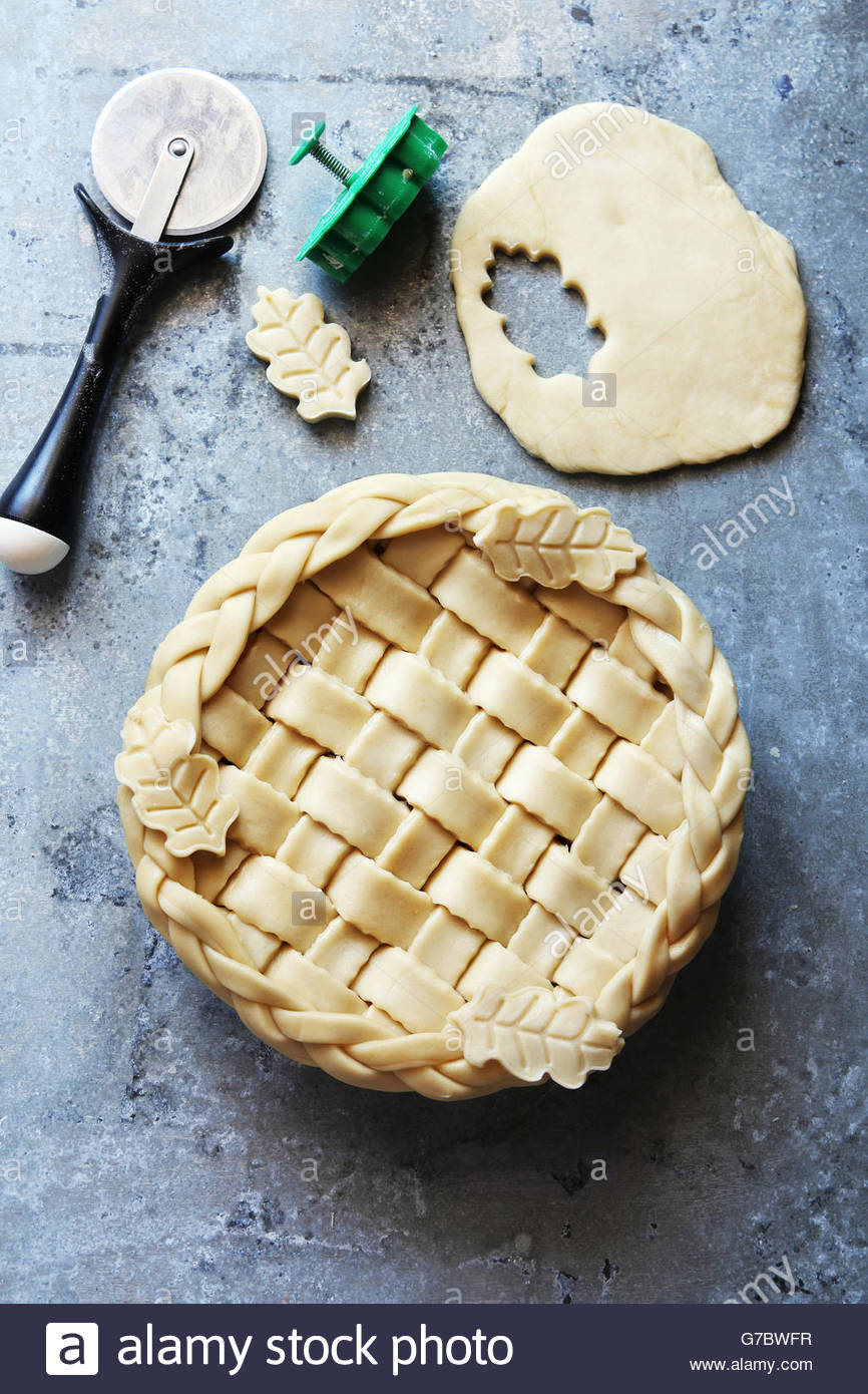 Making pastry crust pie with lattice and leaves.Top view. - Stock Image