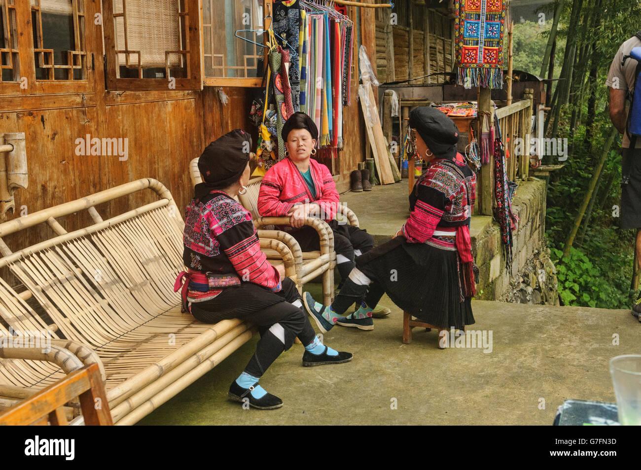 Yao women chatting, Dazhai village, Guangxi Autonomous Region, China Stock Photo