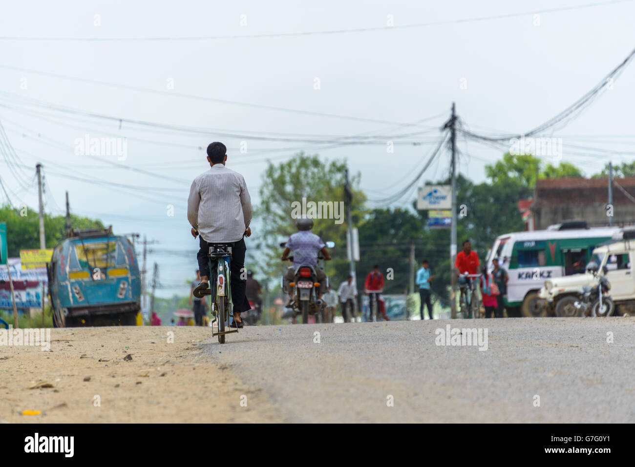 Nepalese man cycling in Tulsipur, Dang District, Nepal - Stock Image
