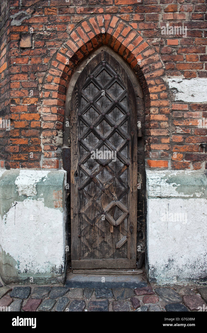 Narrow Gothic Wooden Arched Door To St Marys Church In Gdansk Poland