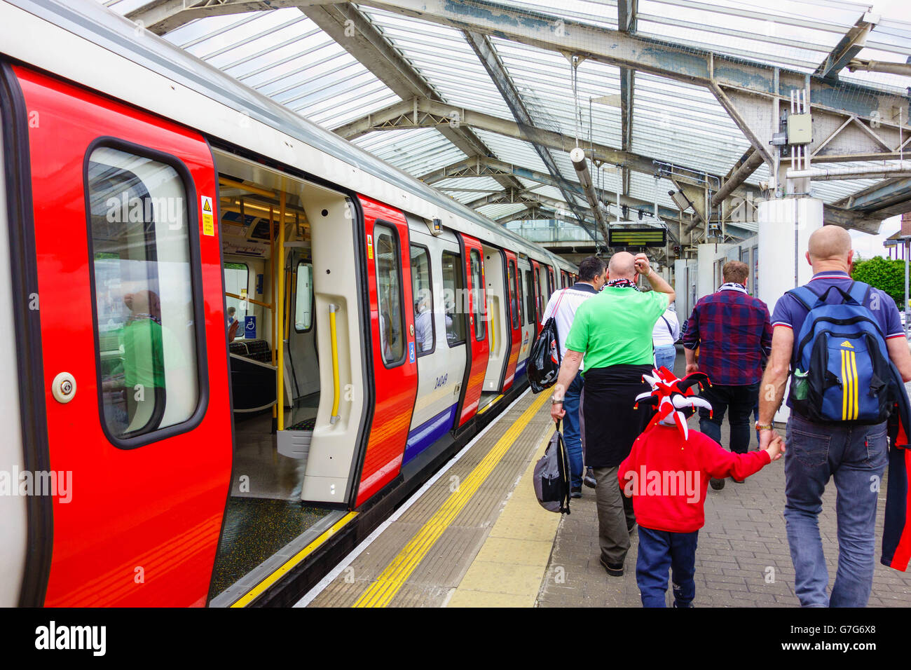 Passengers disembarking the tube at Wembley Park Middlesex - Stock Image