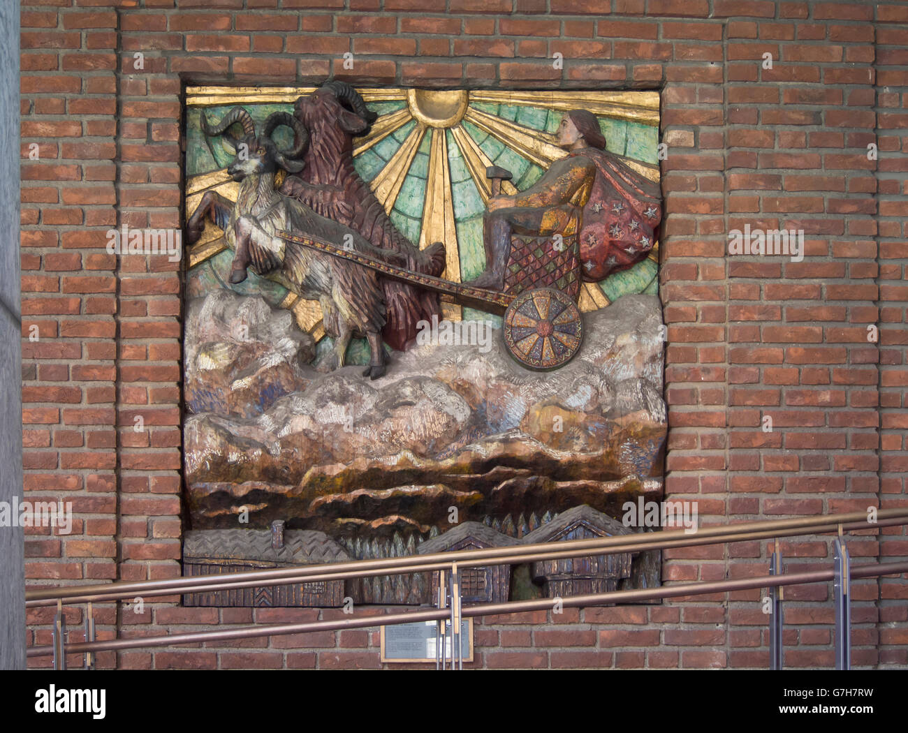 Woodcarving relief on the exterior facade of the Oslo City hall in Norway by Dagfin Werenskiold, the Norse god Thor - Stock Image