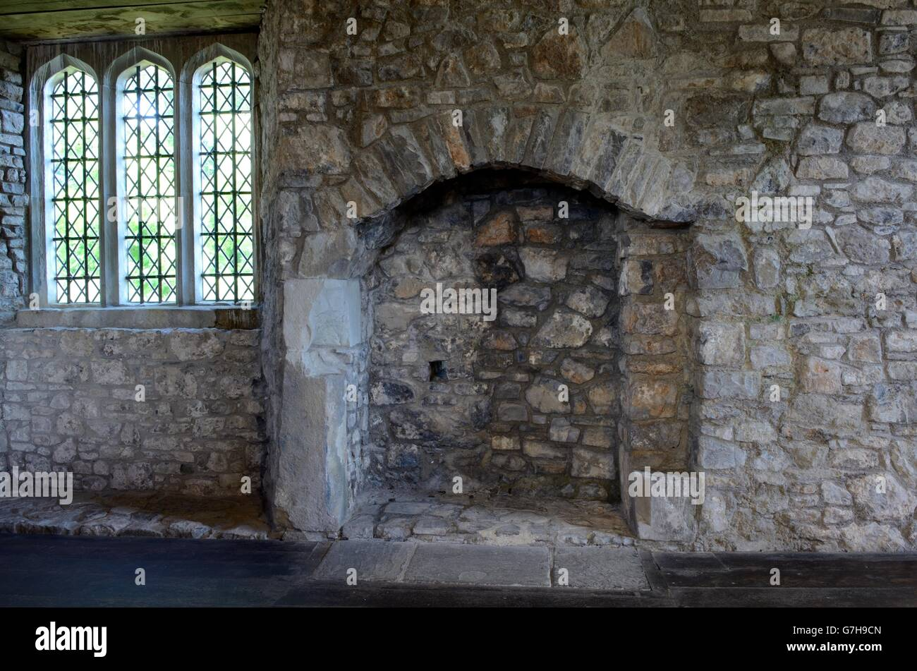 Old stone fireplace and window inside Oxwich Castle Gower Peninsula Wales