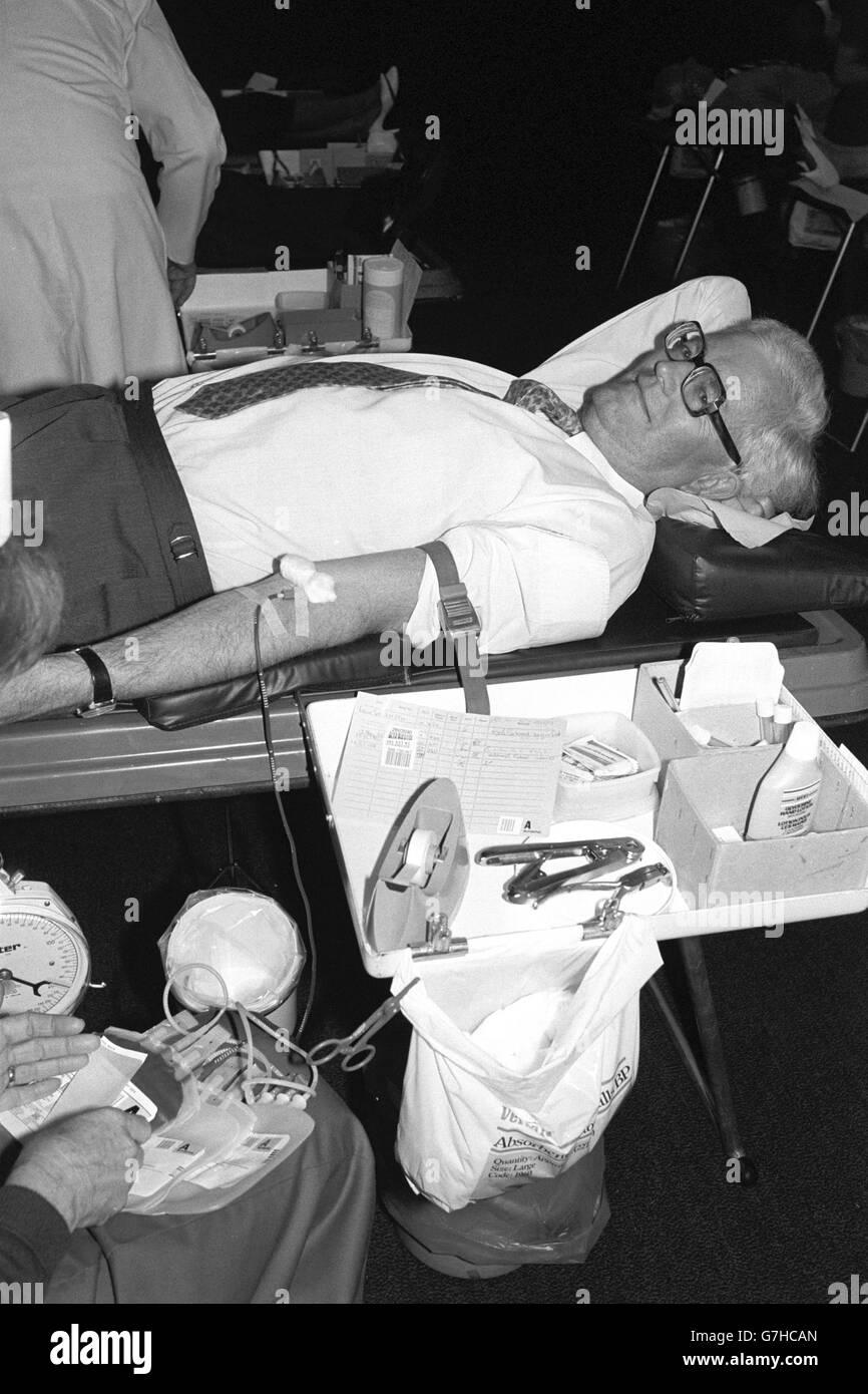 Politics - Blood Transfusion Service - Douglas Hurd - London - Stock Image
