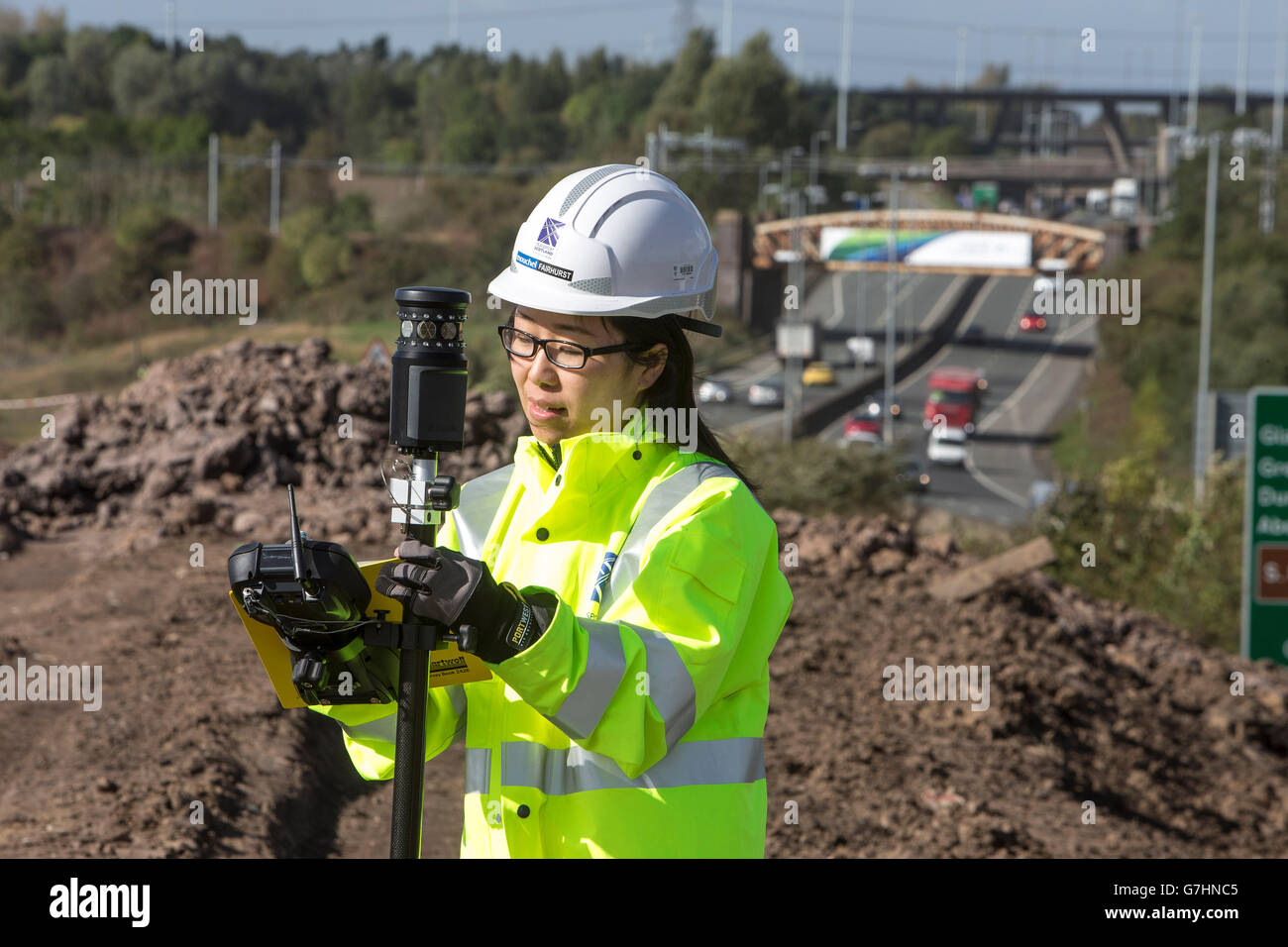 Chinese woman surveyor on location - Stock Image
