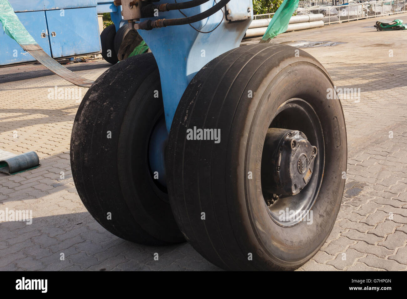 Tires of a giant lifting machine. - Stock Image