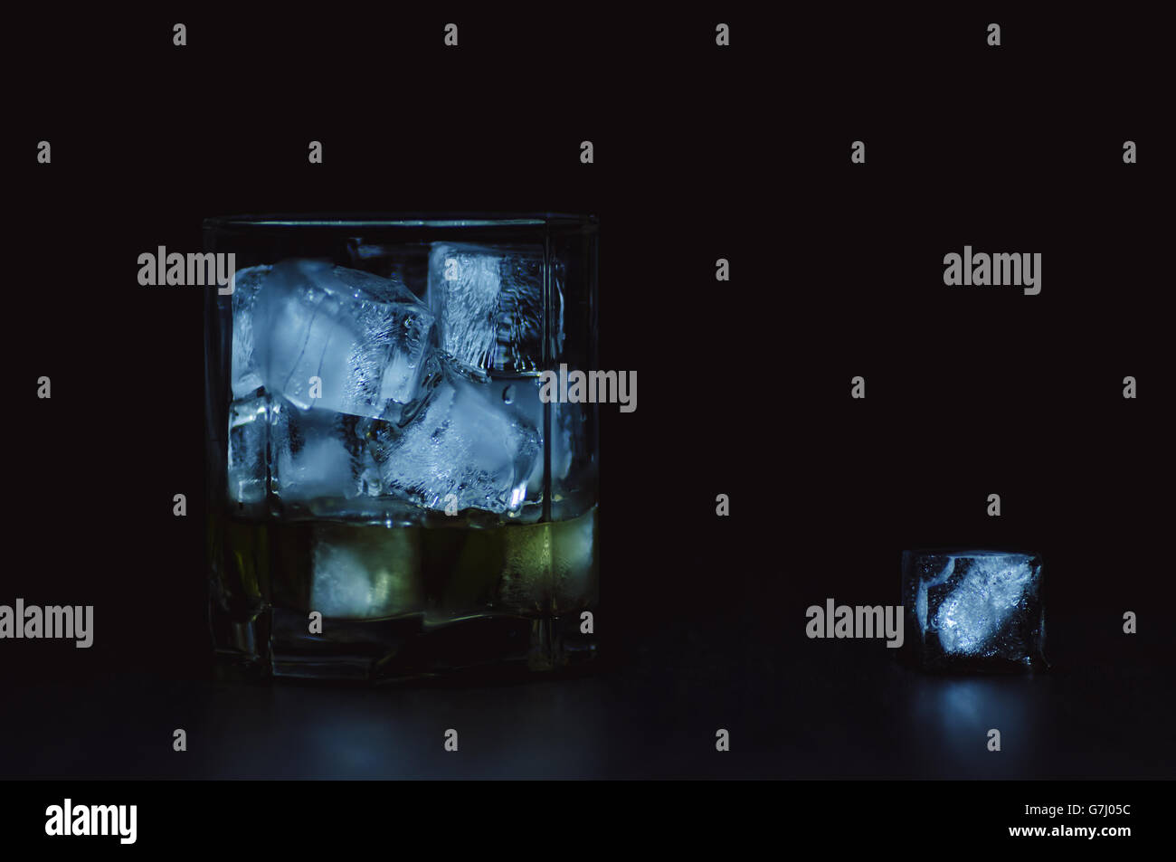 Whiskey with natural ice cold tones - Stock Image
