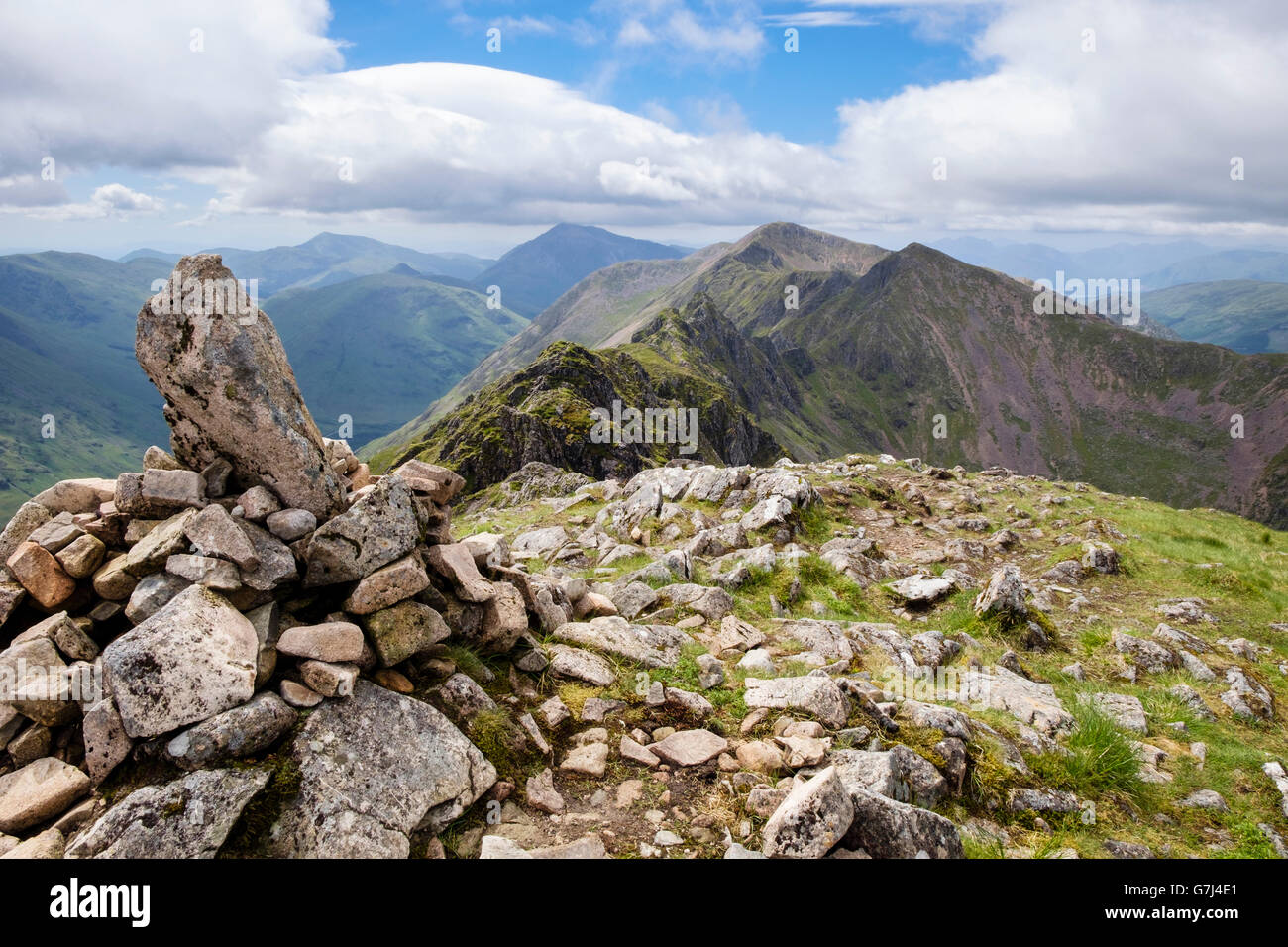 View west on Aonach Eagach (Notched Ridge) seen from Meall Dearg mountain summit cairn in summer in Scottish Highlands. - Stock Image