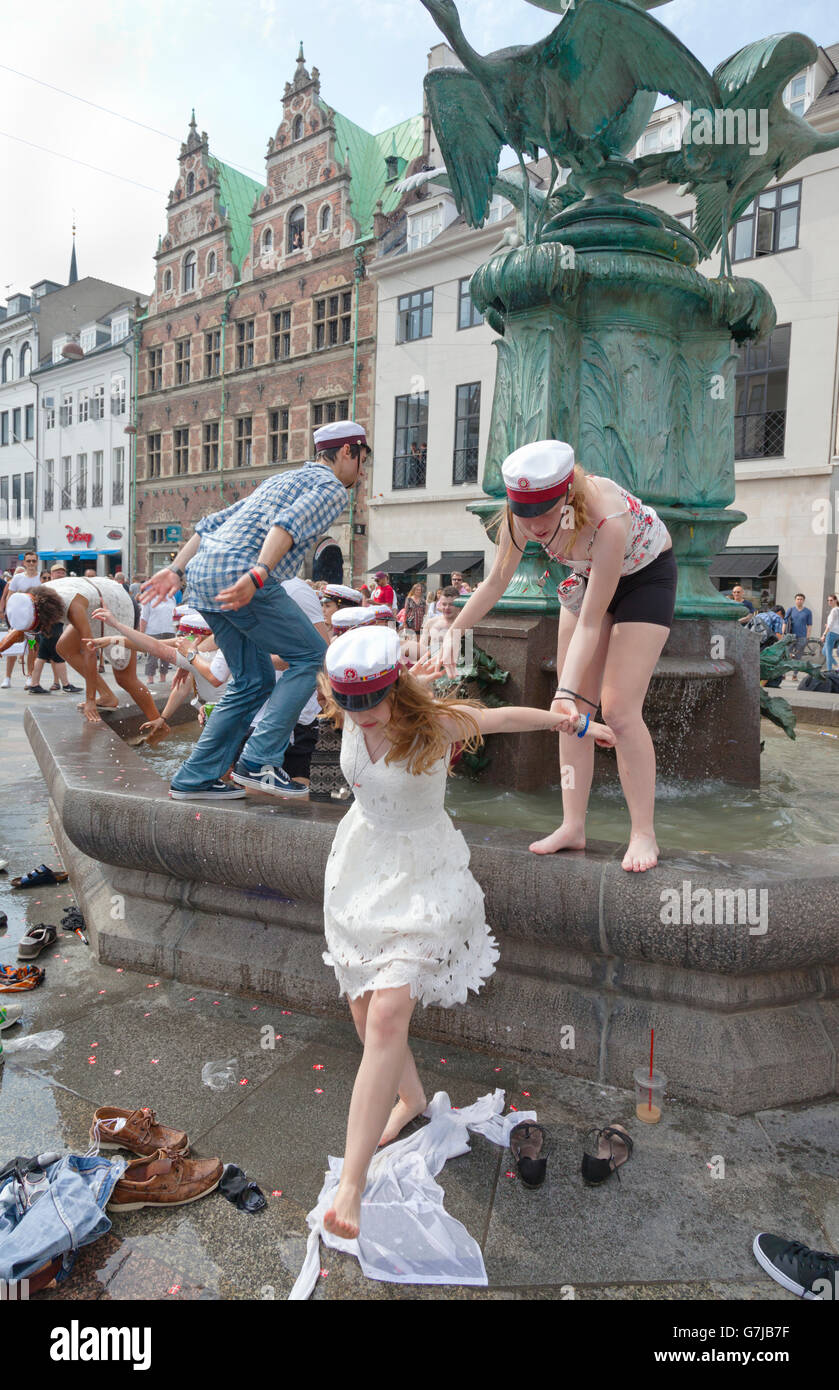 Danish students celebrate their high school graduation with the traditional dip in the Stork Fountain, Storkespringvandet, - Stock Image