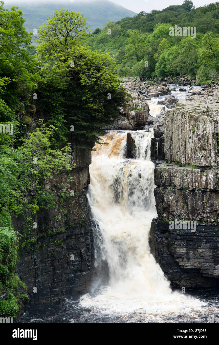 Summer rainfall plunging over the Great Whin Sill, High Force, Teesdale, County Durham, England, UK - Stock Image