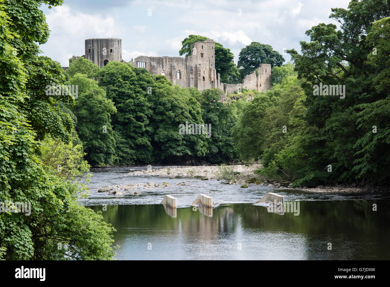 The 12th century castle built by Bernard de Balliol reflected in the River Tees, Barnard Castle, County Durham, - Stock Image