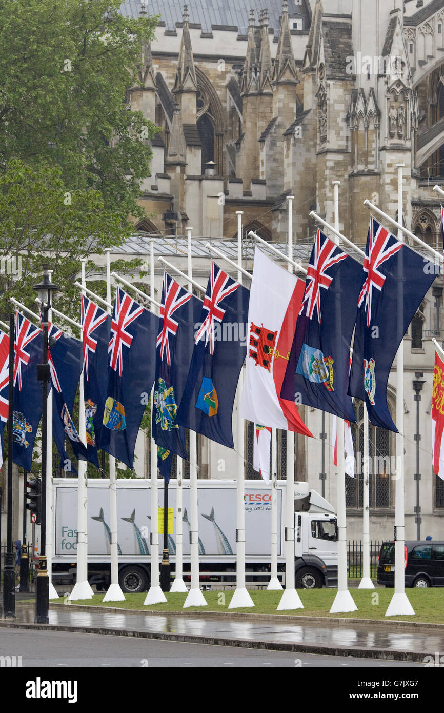 flags of the Crown Dependencies and Overseas Territories flying in Parliament Square - Stock Image