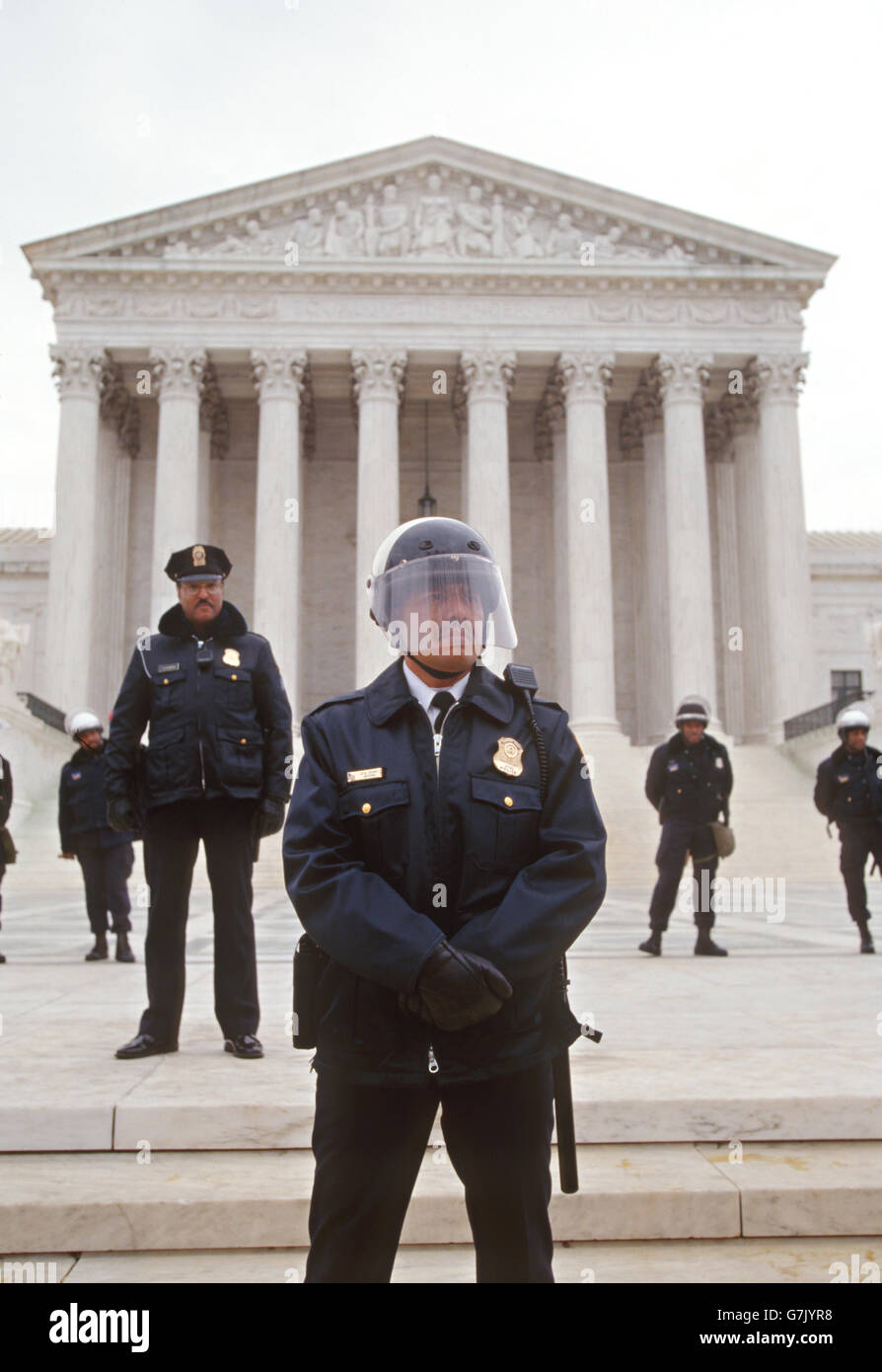 Police wearing riot helmets stand guard in front of the U.S Supreme Court building on the anniversary of the abortion - Stock Image