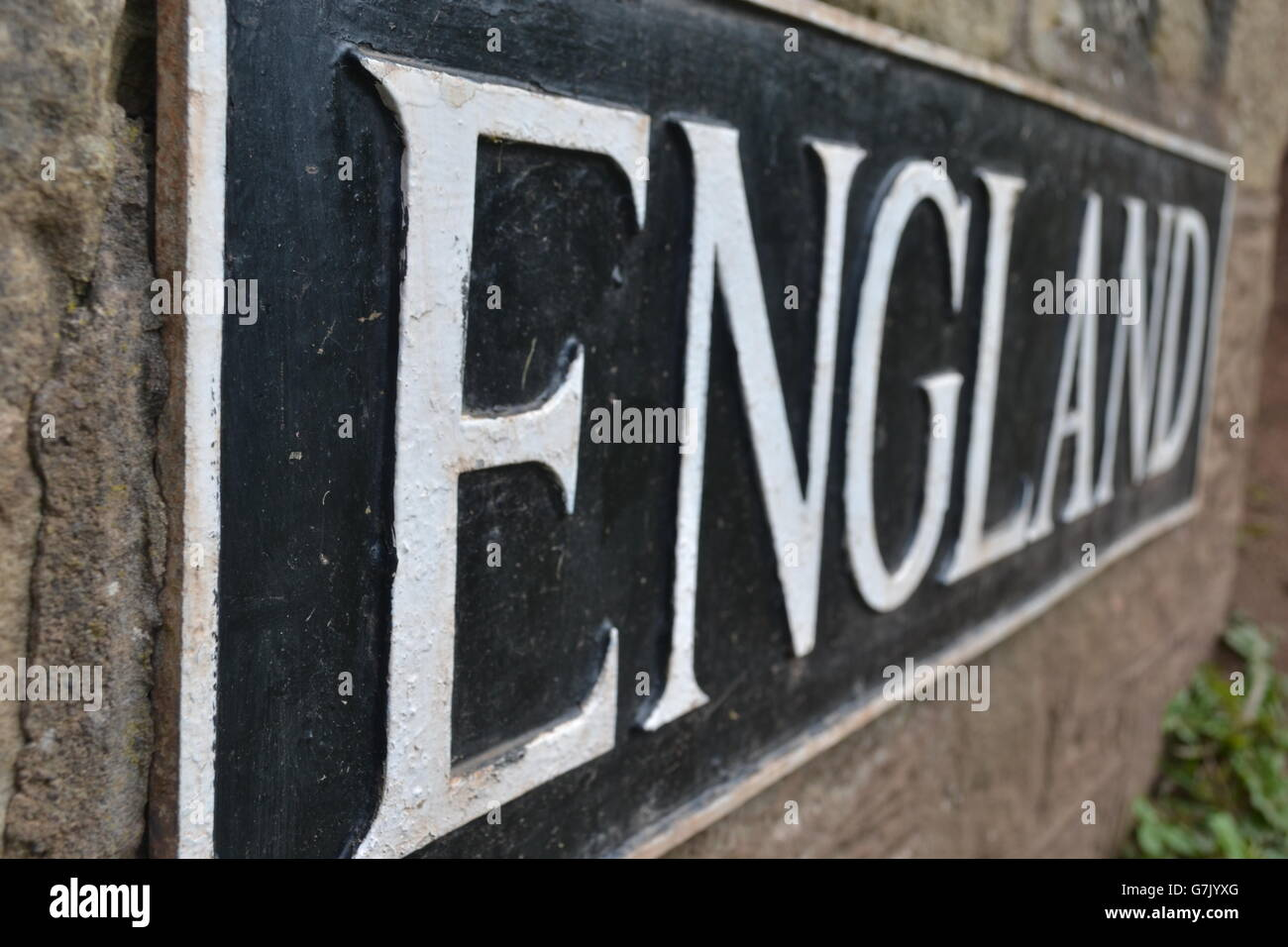 black & white England sign on a wall country plaque capital letters abstract plaque - Stock Image