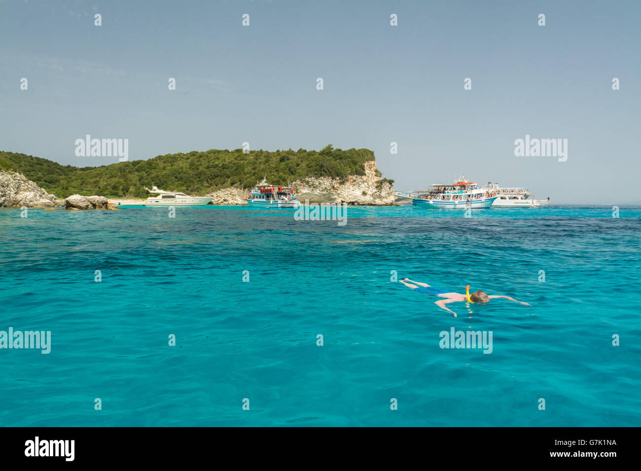 Antipaxos snorkelling - tourist cruise boats anchored off the tiny Ionian island of Antipaxos to enable tourists - Stock Image