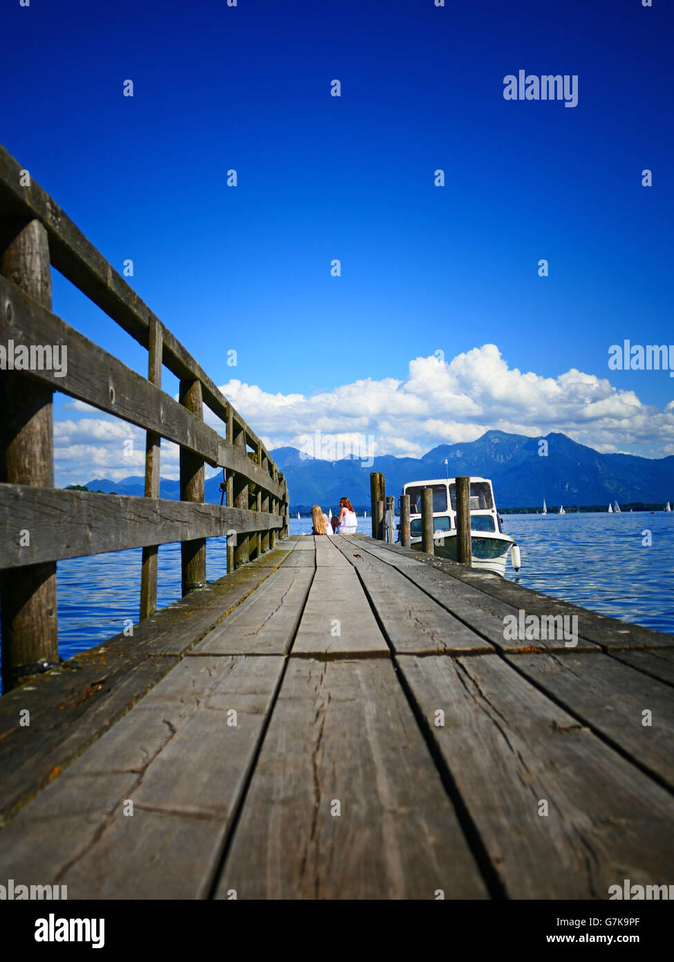 Europe Germany Chiemgau Chiemsee lake Prien wooden bridge boat mooring Stock Photo