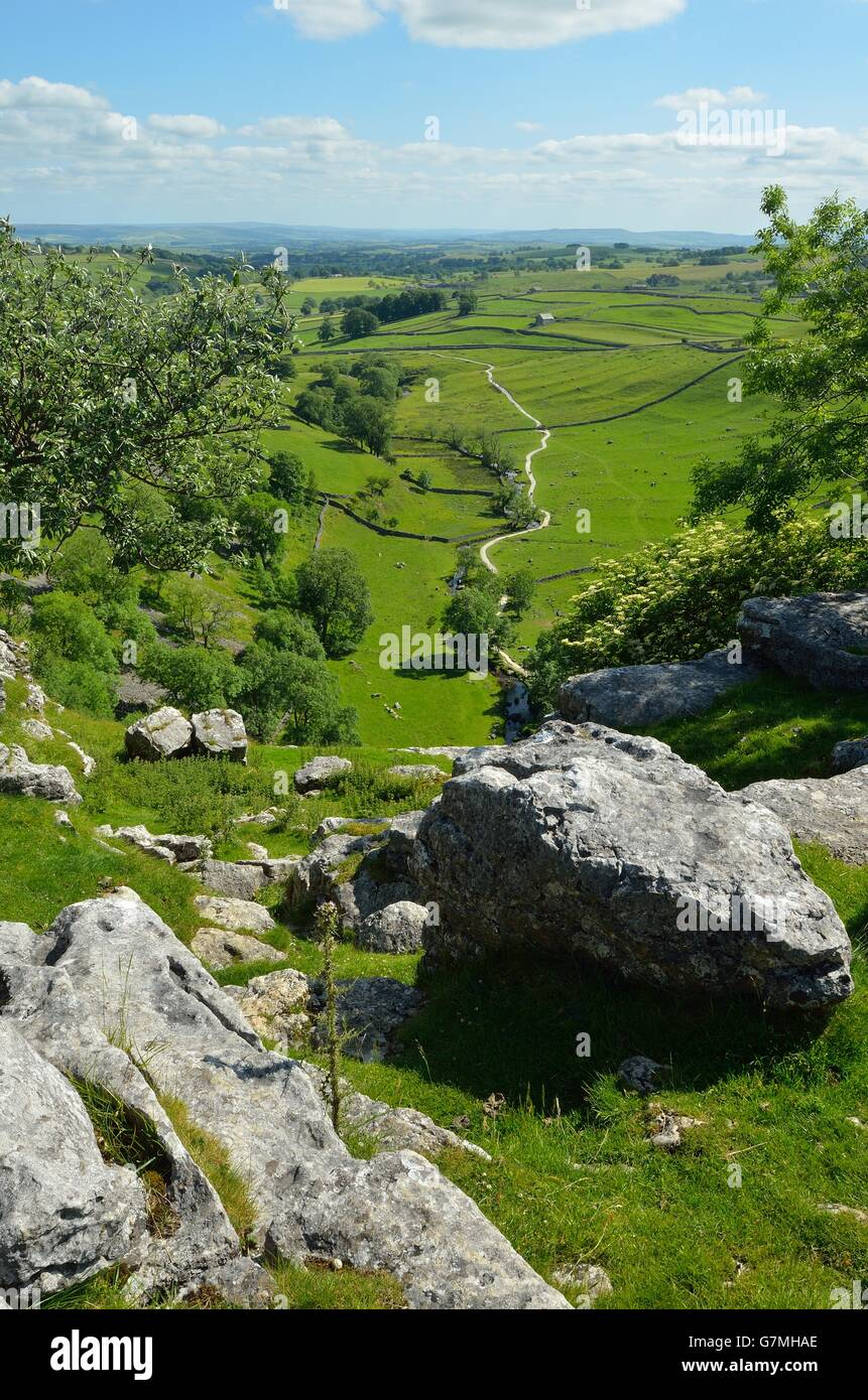 View from the limestone pavement above Malham Cove, Yorkshire Dales National Park, near Settle, West Yorkshire - Stock Image