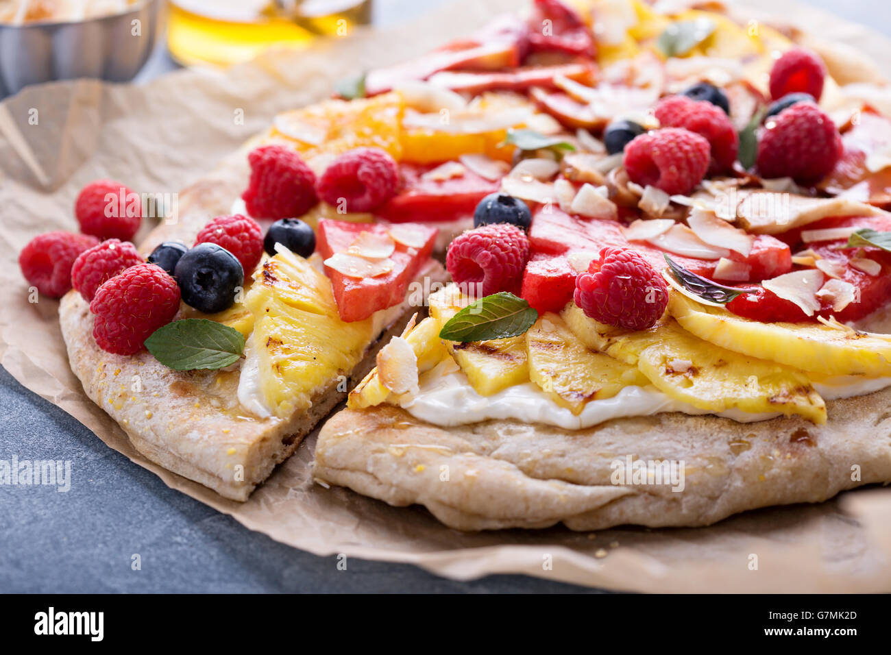 Grilled fruit pizza with honey - Stock Image