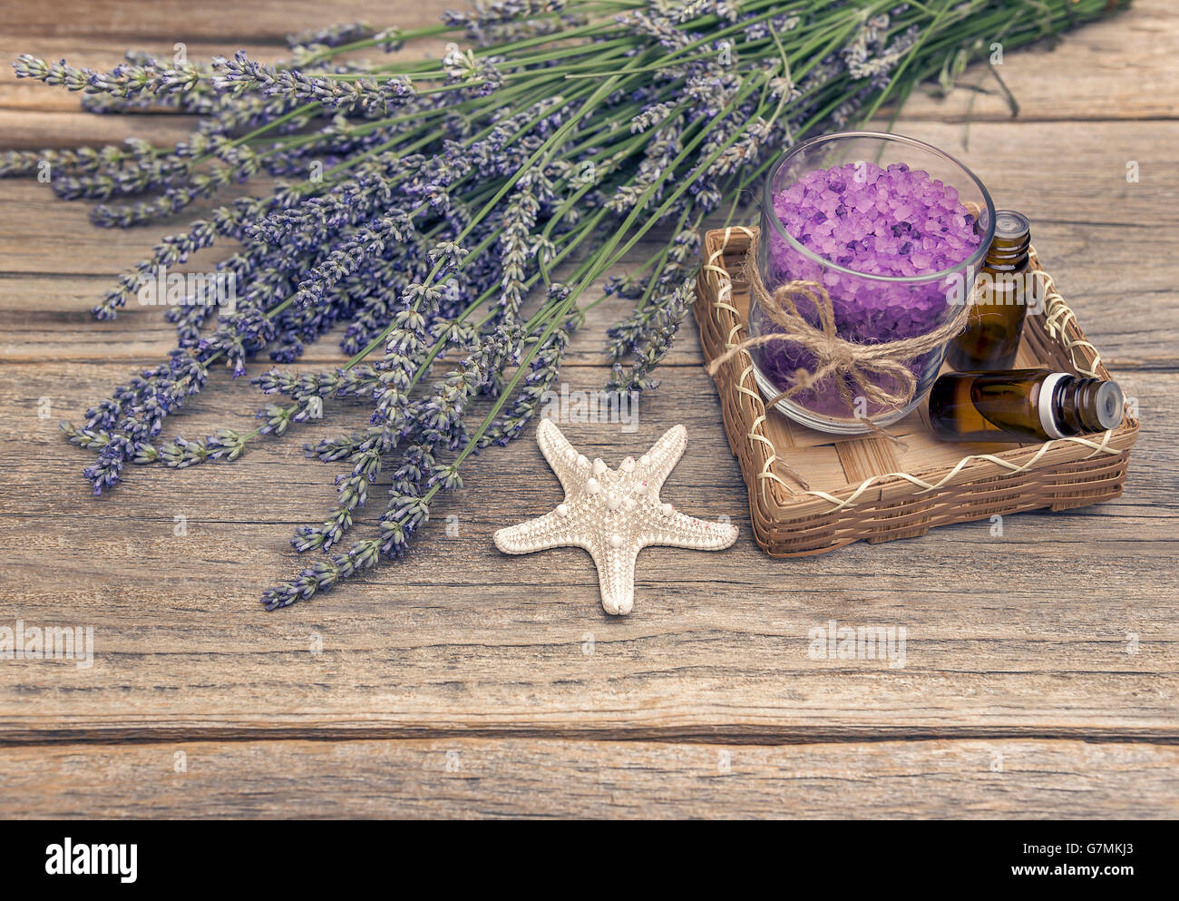Lavender and sea salt on wooden boards. Still life. Stock Photo