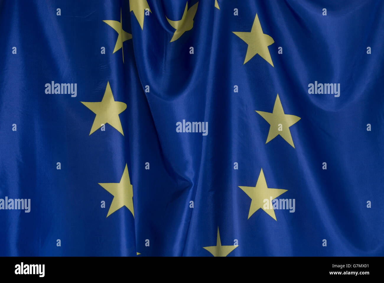 Brexit concept. Crumpled EU European community flag as visual metaphor for disunity, turmoil and the UK leaving - Stock Image