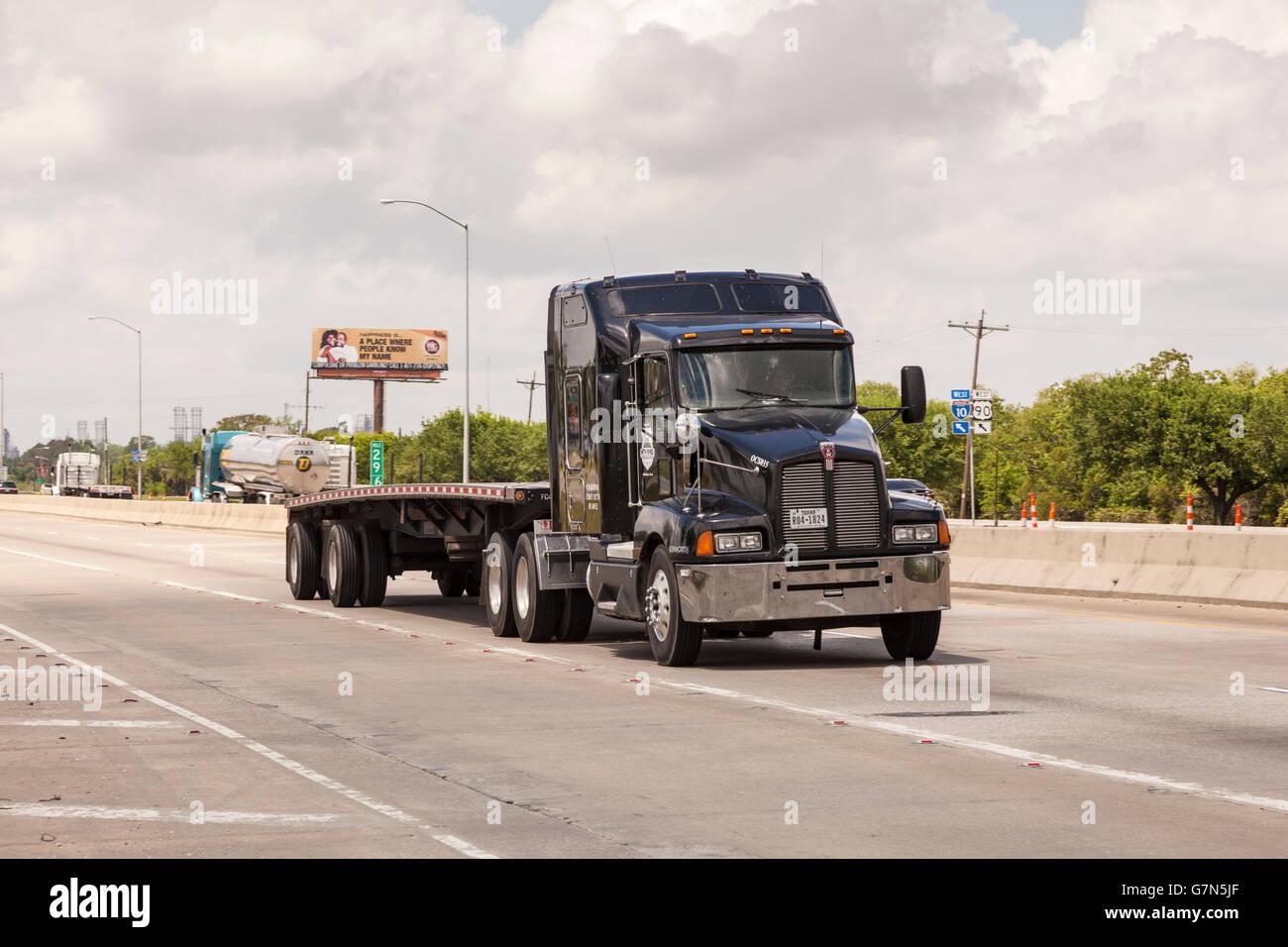 Black Kenworth Truck on the highway - Stock Image