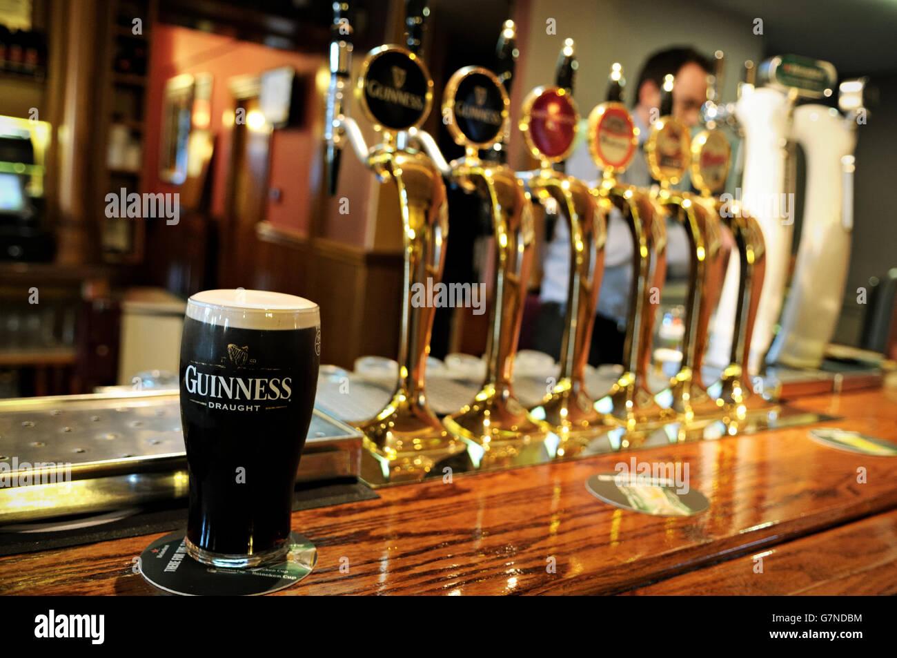 One pint of Guinness inside a pub of Dublin, Ireland Stock Photo