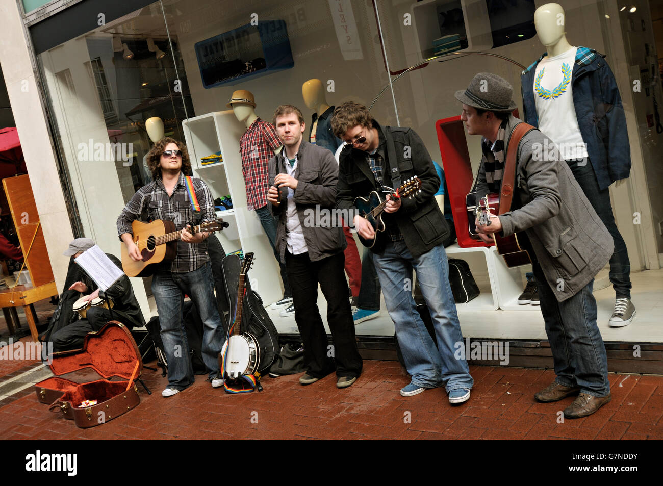 Five Irish musicians busking in Grafton Street in the city centre of Dublin, Ireland Stock Photo