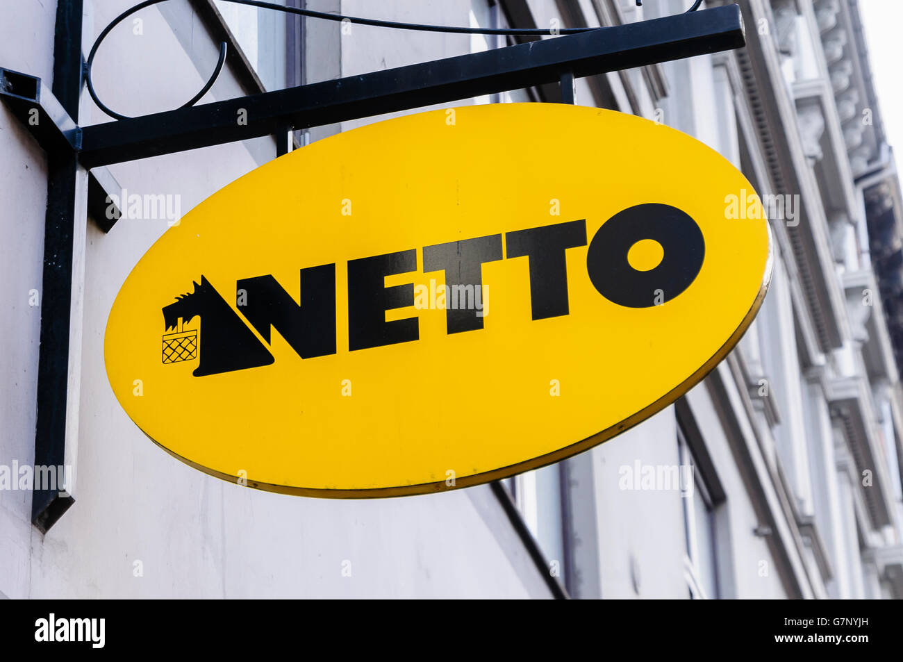 Sign for Netto, a Denmark based supermarket chain, with their Scottish Terrier logo - Stock Image