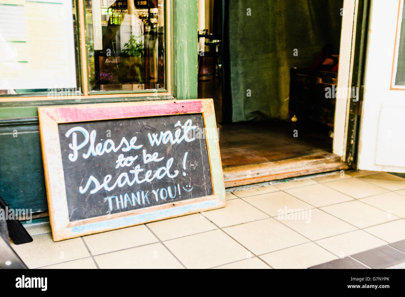 Sign Outside A Restaurant Saying Please Wait To Be Seated Thank