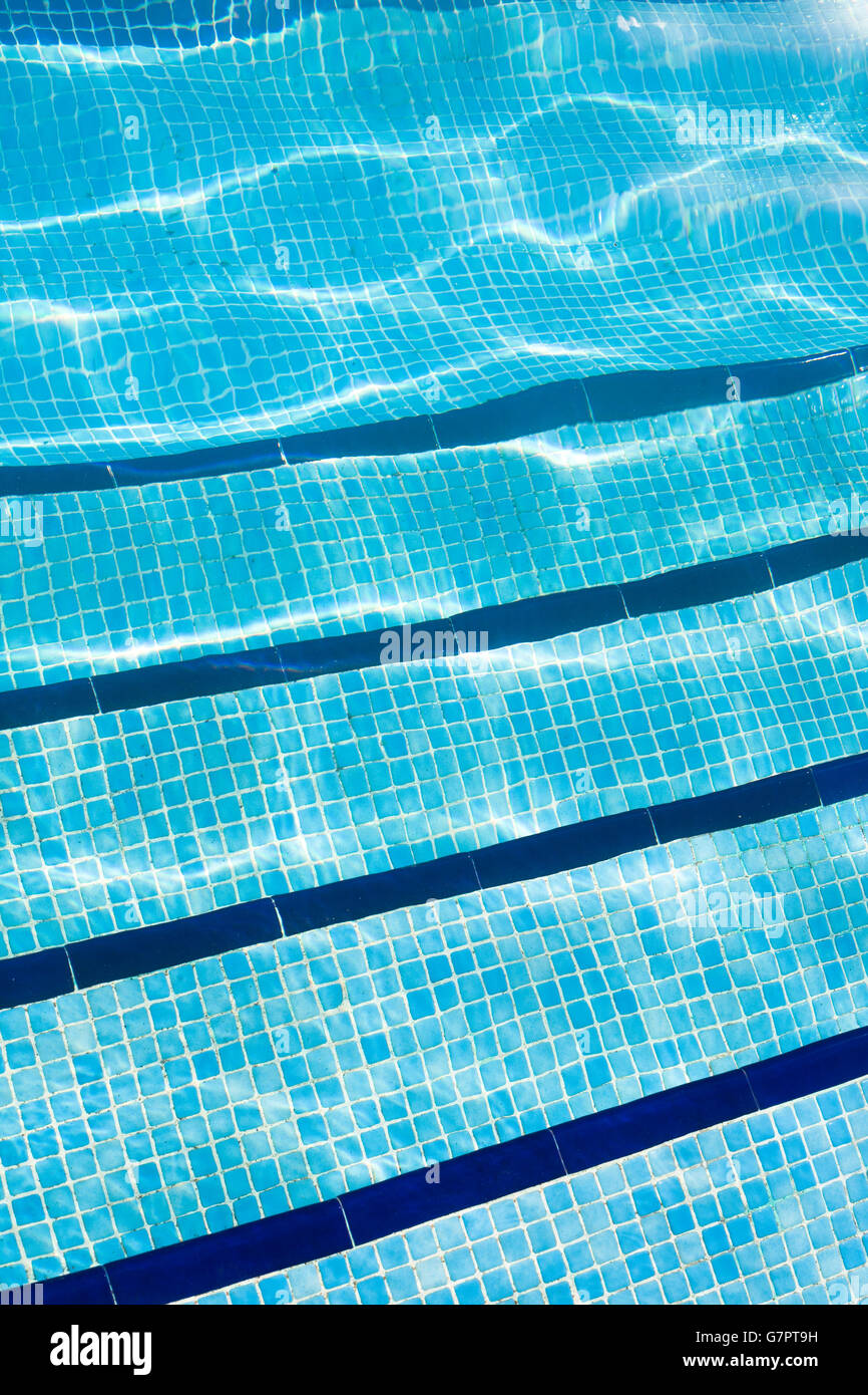 Detail of Swimming pool with sunlight reflecting on the water. - Stock Image