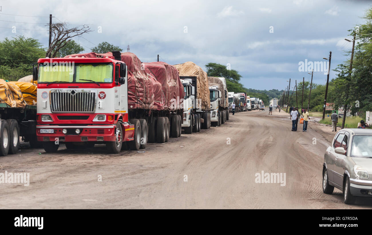 Row of trucks / lorries at the border post on the Zamibian side of the Kazungula Ferry to Botswana, southern Africa. - Stock Image
