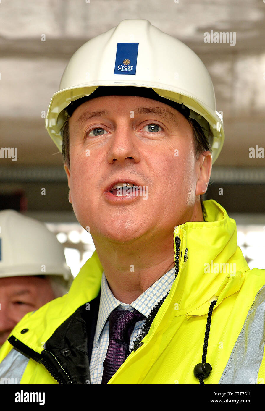 Prime Minister David Cameron wearing a hard hat and high visibility jacket, during a visit to a building site where they are constructing private flats in Isleworth, west London. Stock Photo