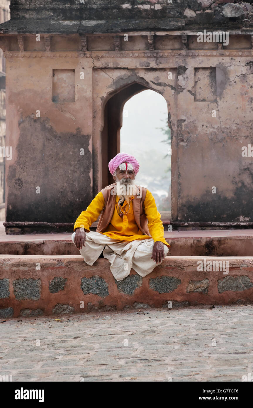 Unidentified Indian Sadhu sitting near Temple on the street - Stock Image