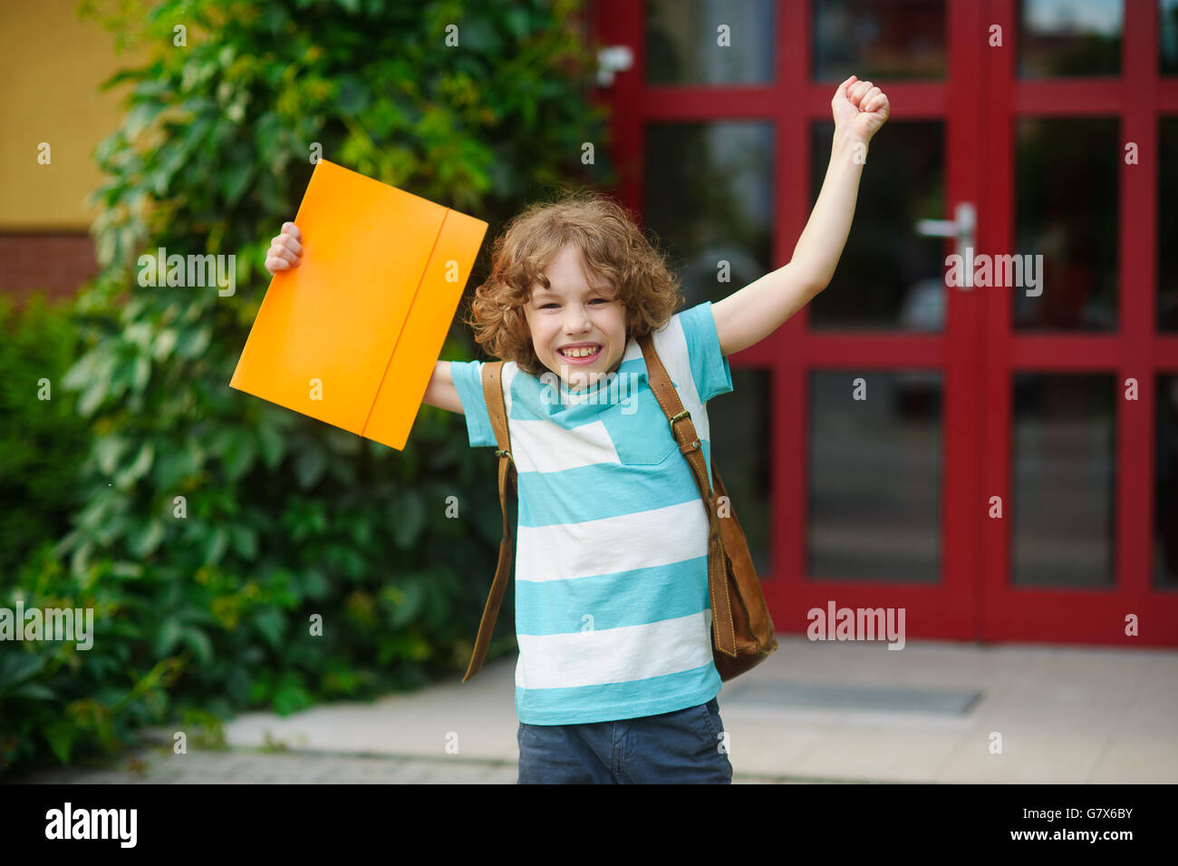 The schoolboy rejoices to the termination of academic year and the beginning of summer vacation. The fellow has - Stock Image