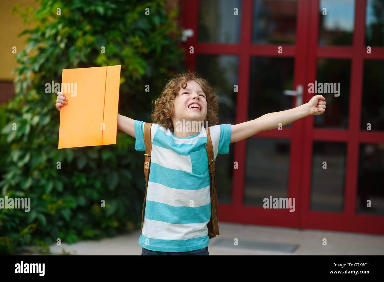 The little school student rejoices to the termination of academic year and the beginning of summer vacation. The - Stock Image