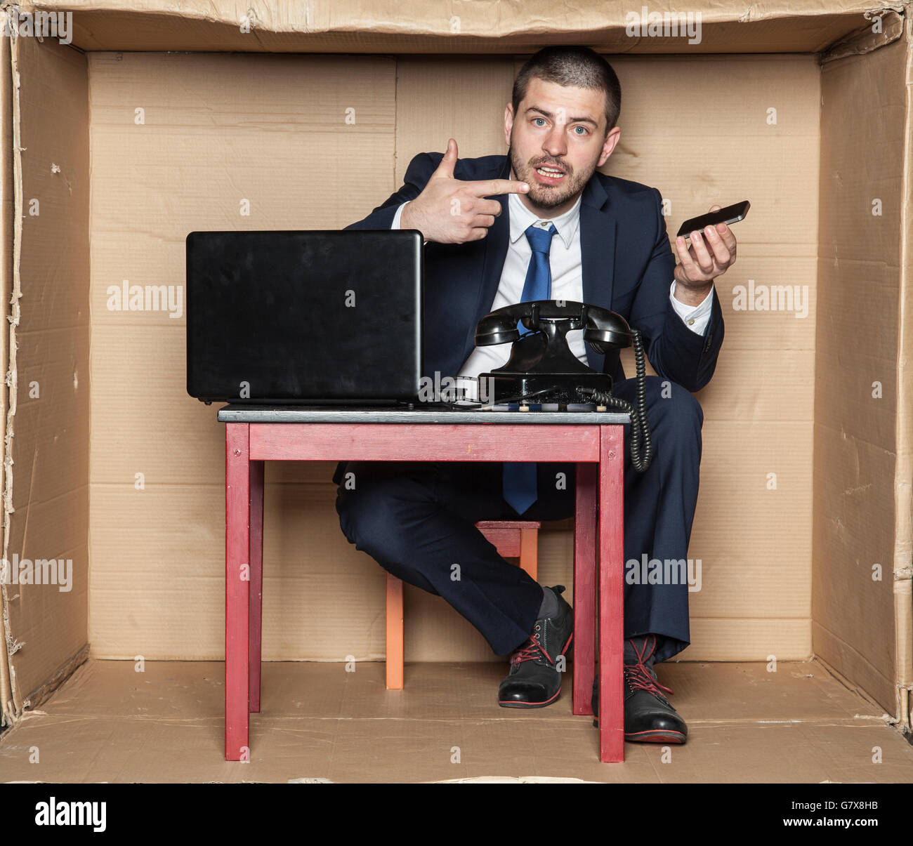 businessman can not handle a mobile phone Stock Photo