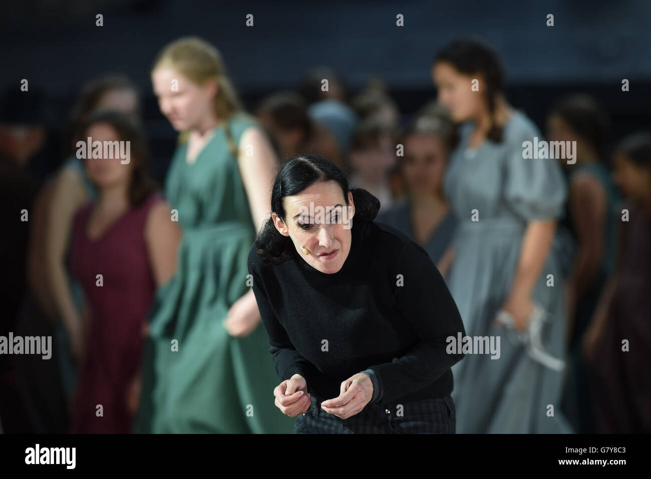 Actress Viola von der Burg as Narrator/Johanna/Godfather performs during a photo rehearsal of a scene of the play - Stock Image