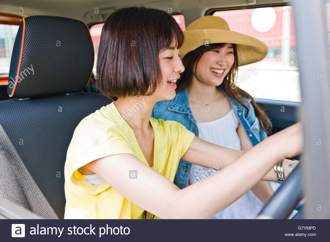 Woman driver setting the car navigation system - Stock Image