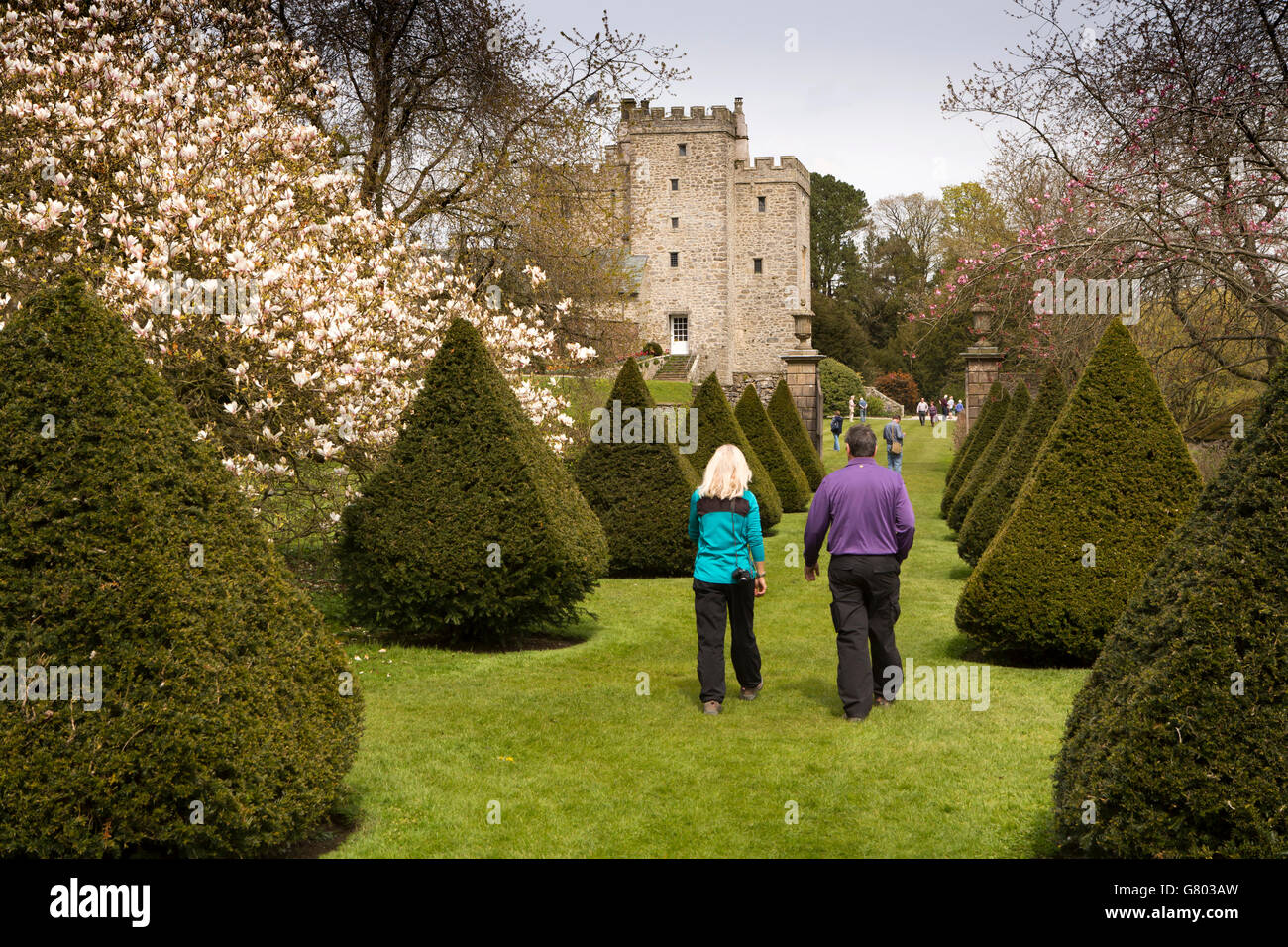 UK, Cumbria, Kendal, Sizergh, ancestral home to the Strickland family, visitors in topiary garden - Stock Image