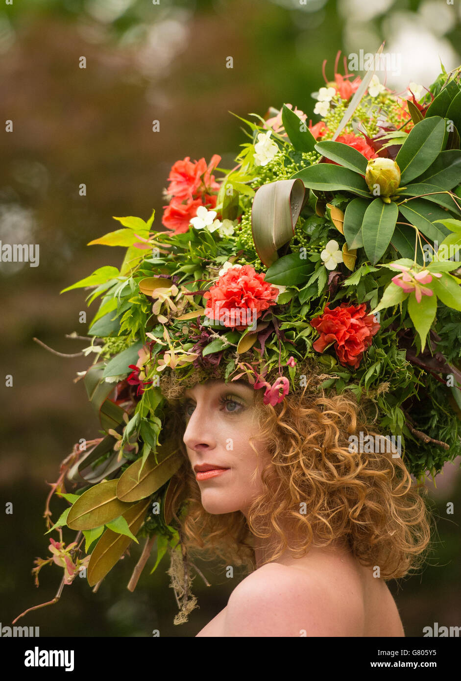 A model displays a floral dress and hat created by floral stylists Okishima & Simmonds for the Hillier Nurseries Stock Photo