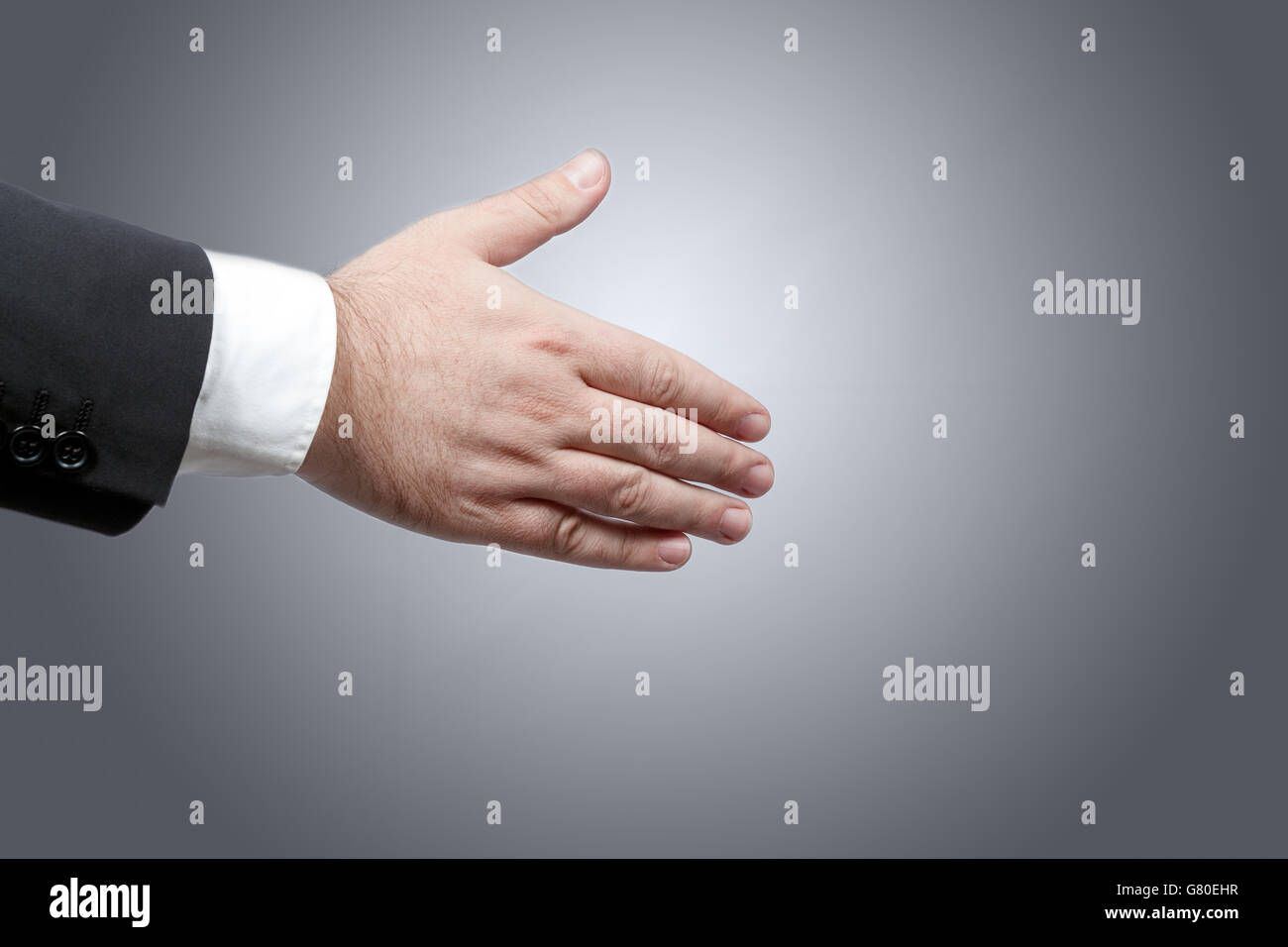 Business man right hand ready to shake another hand sealing a contract - Stock Image