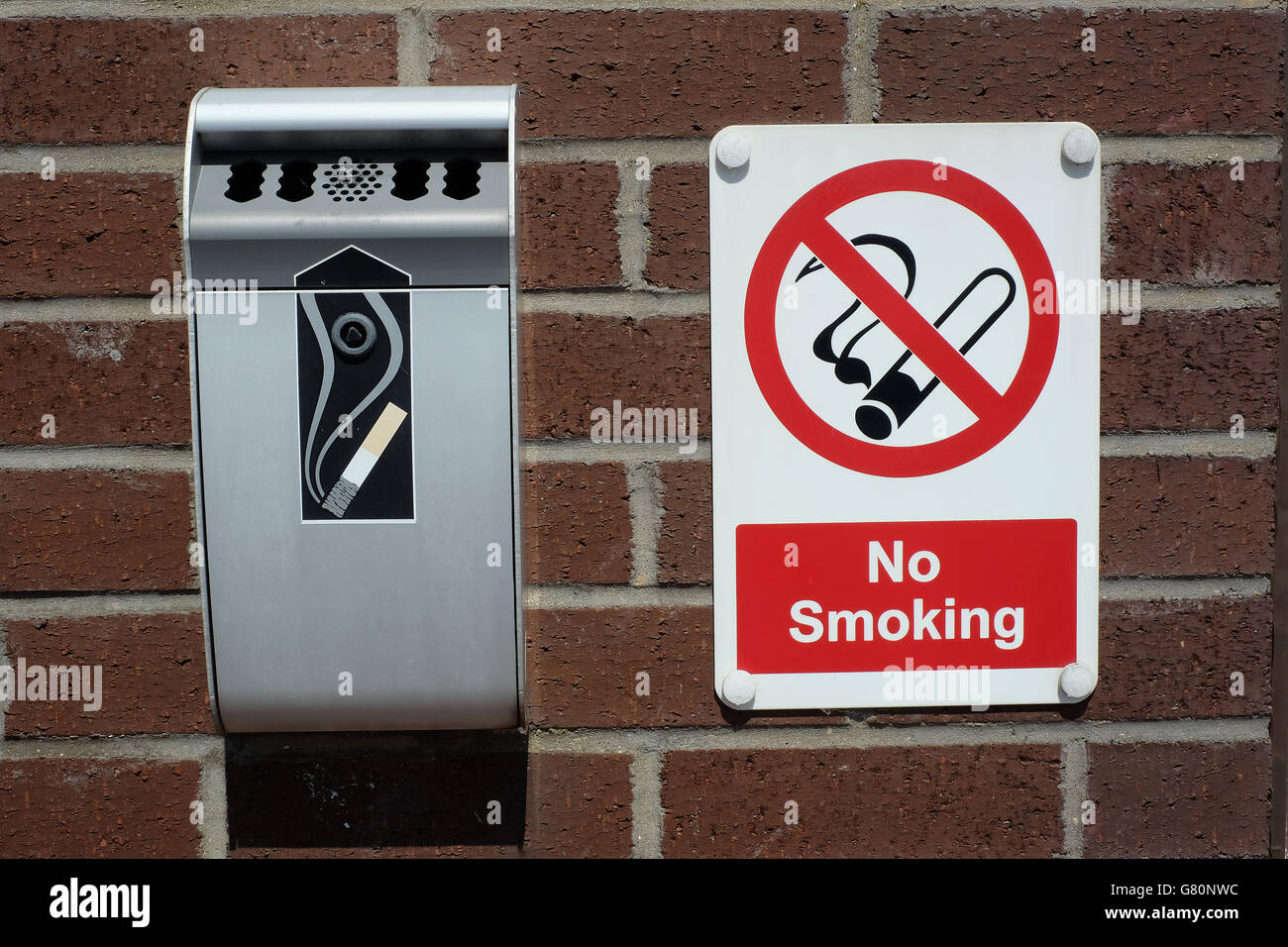 No smoking sign and cigarette waste receptacle. - Stock Image