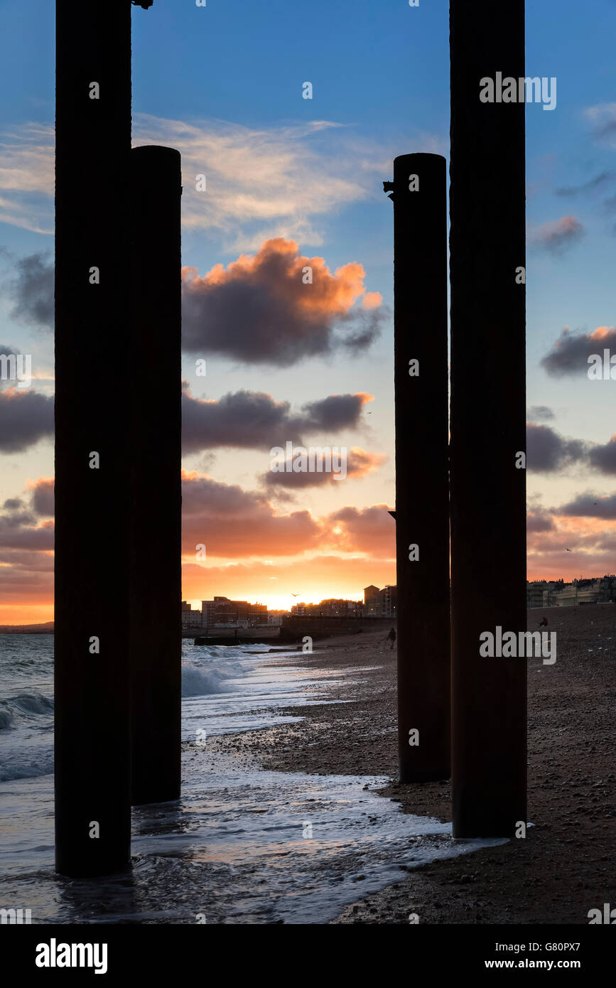 Sunset over Hove Brighton beach West Pier Sussex, England - Stock Image