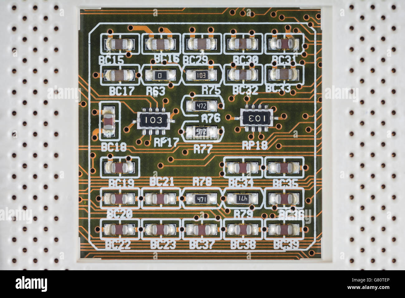 Concept - computer technology / cpu / circuit architecture . Socket 7 with surface mount components below CPU chip. - Stock Image
